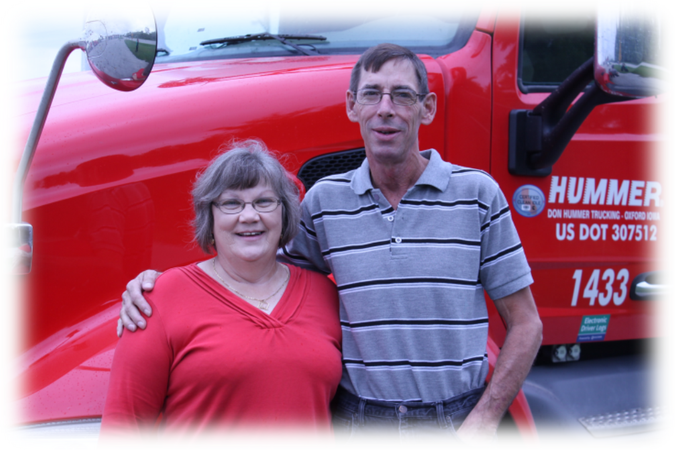 Image of two Don Hummer Trucking team truckers.
